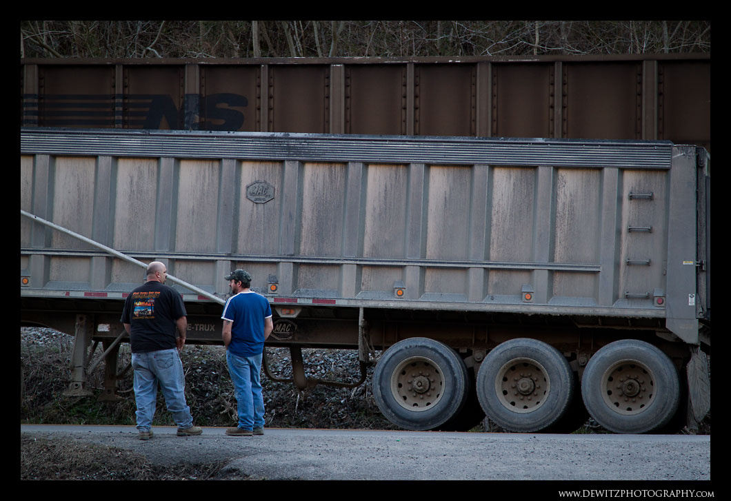 Coal Truck Drivers Waiting for the Train