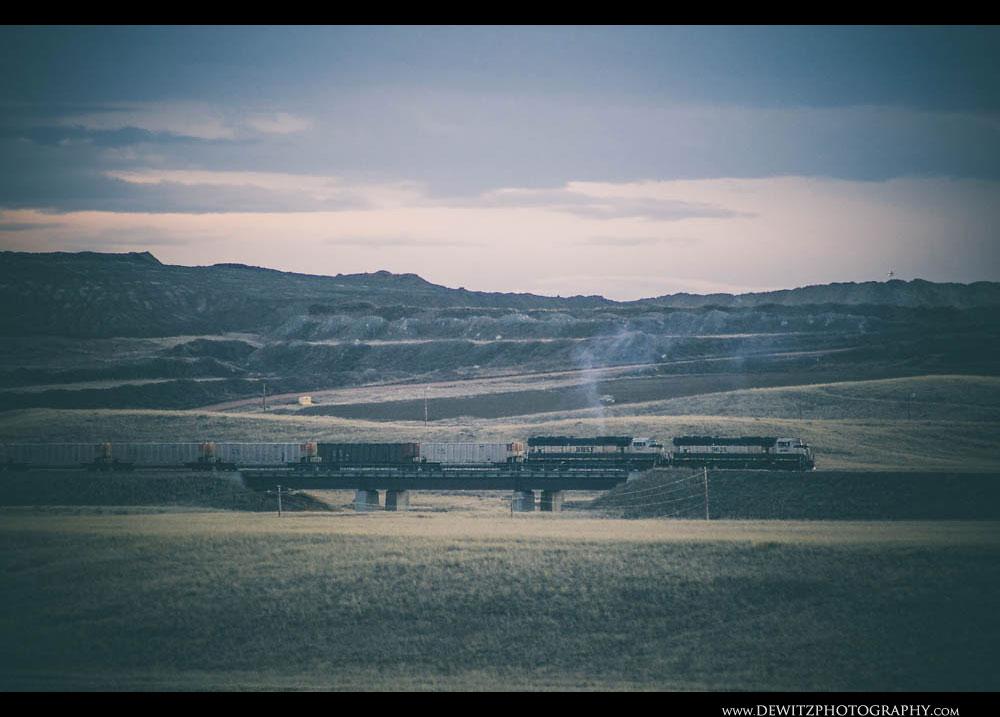 102BNSF Coal Train Passes Open Pit Mine