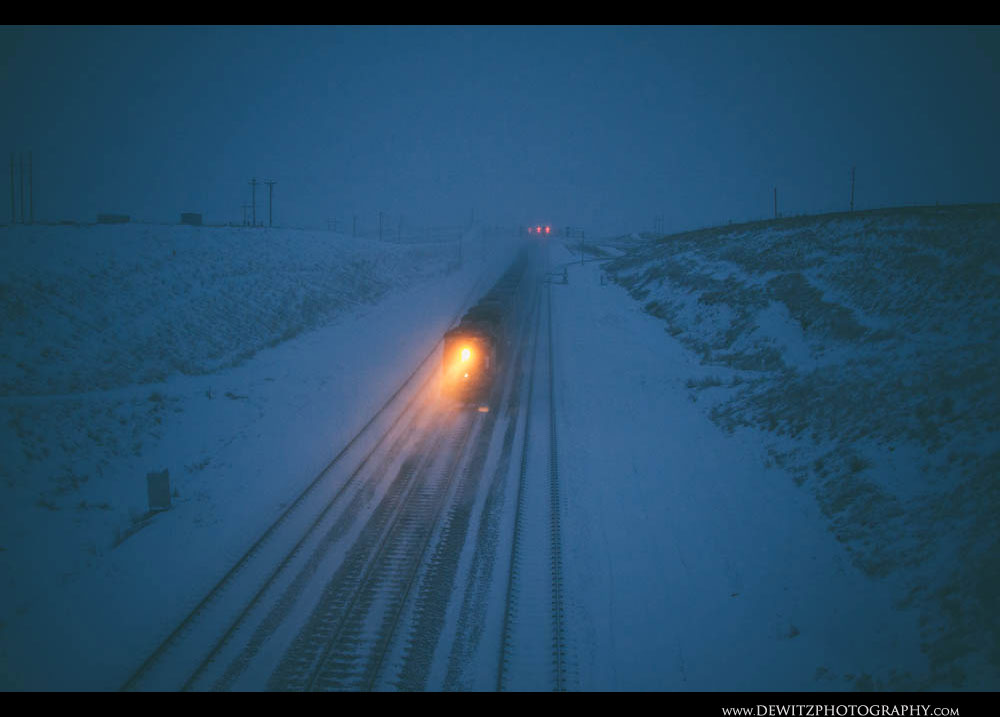 137DPU Pushes Tonnage Up the Grade as Snow Falls Before Sunrise