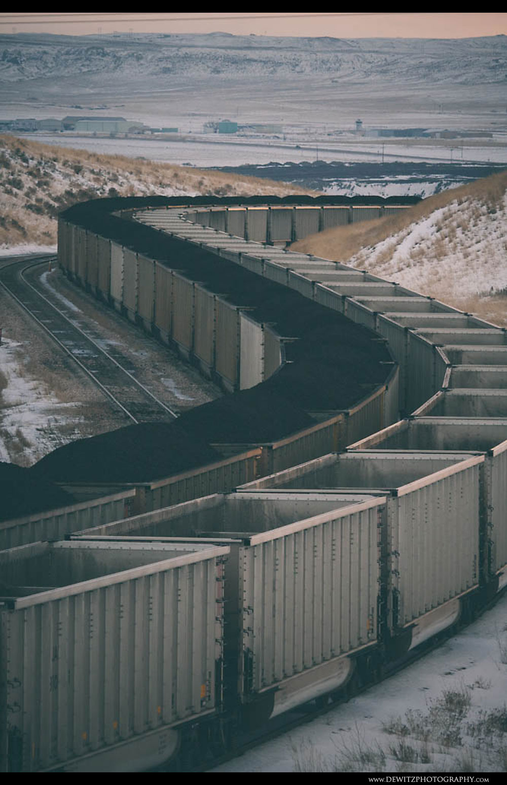 138Loaded and Empty Aluminum Coal Hoppers Curve Through the Landscape