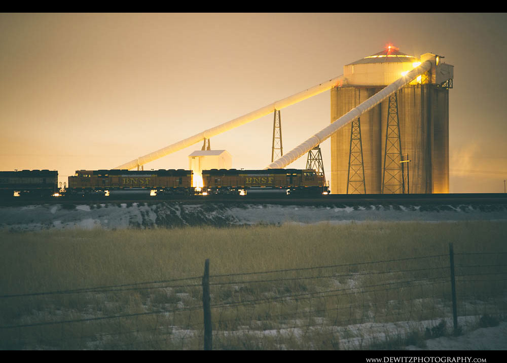 157The Yellow Glow of Lights Reflects Off the Tall Concrete Coal Silos