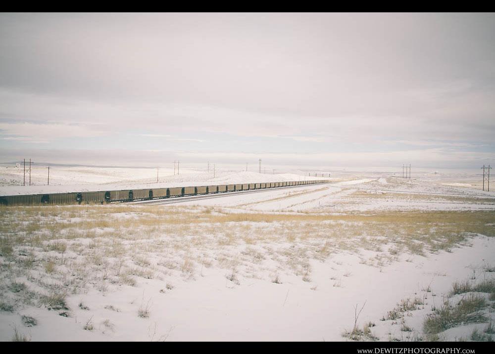 158Aluminum Coal Hoppers Stretch Across Wyoming Landscape