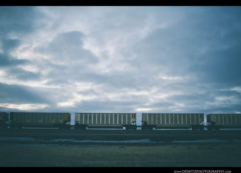174Clouds Move Over Aluminum Coal Hoppers