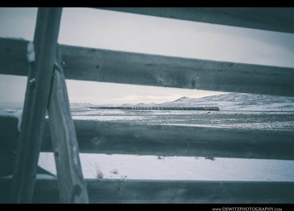 199CNW Unit Leads Coal Train as Seen Through a Snow Fence