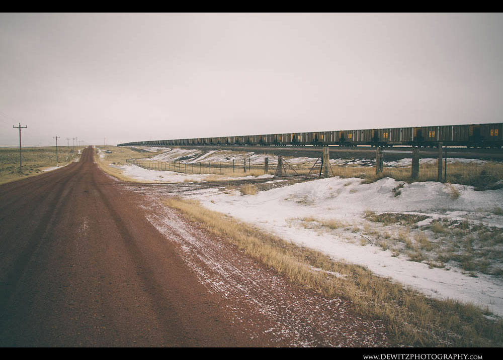 259A String of Coal Cars Travel Along the Red Rock Dirt Hilight Road