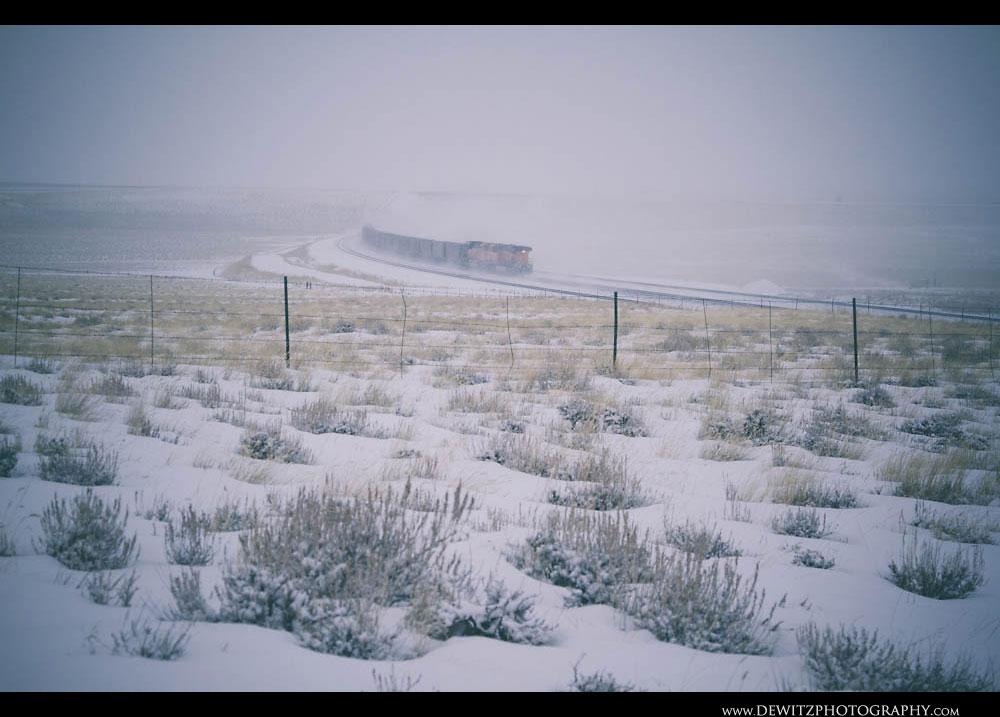263BNSF Coal Train Kicks Up Snow as it Heads North Up the Orin Sub