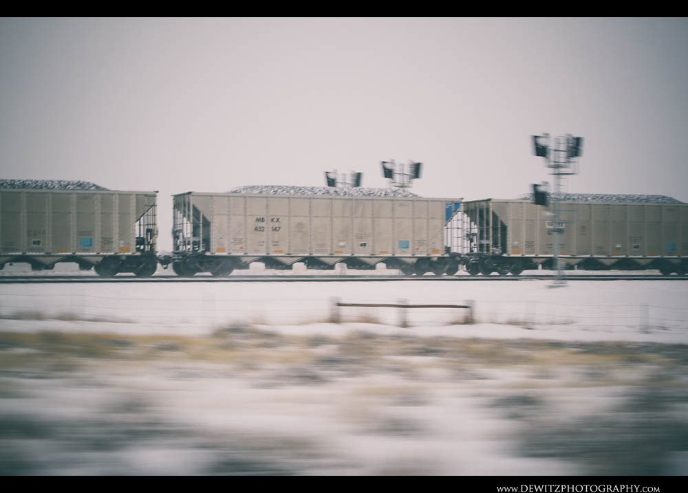 31Loaded Coal Hoppers Fly Through the Snow Past Signals in the PRB