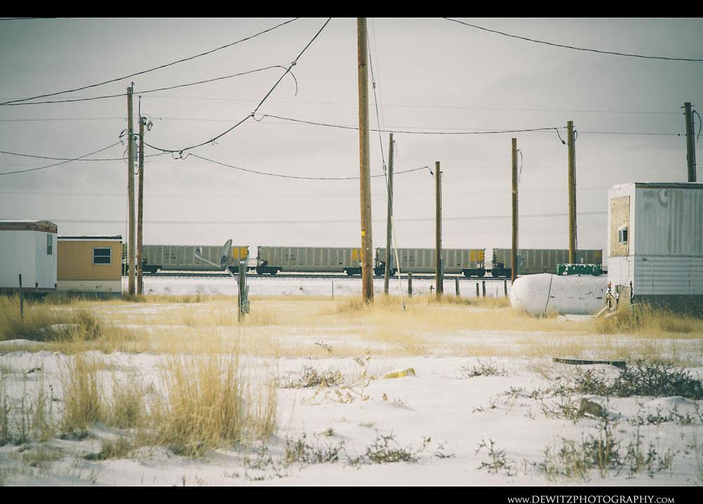 323Aluminum Coal Hoppers Outside Snow Covered Trailer Houses
