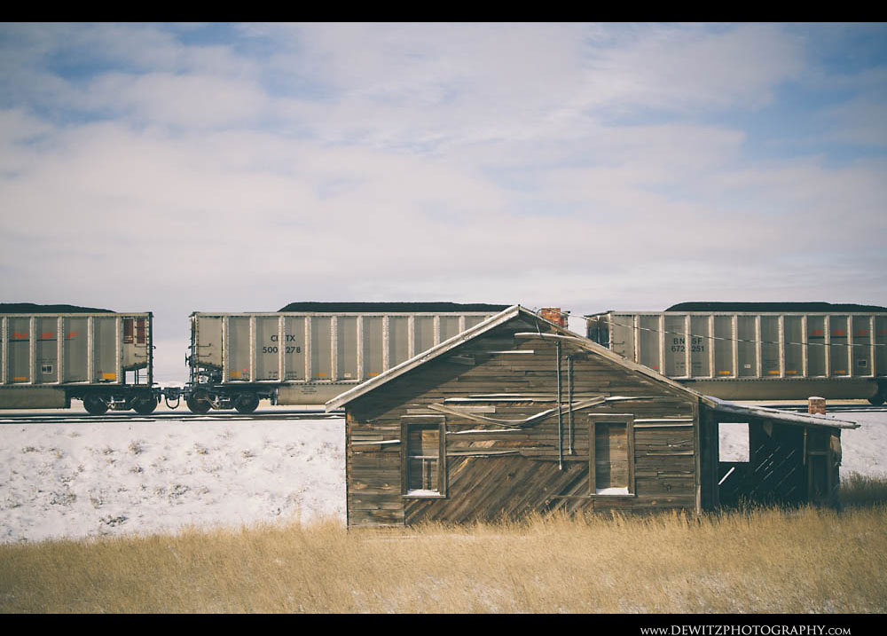 357Loaded Coal Hoppers Sit Behind Abandoned Home