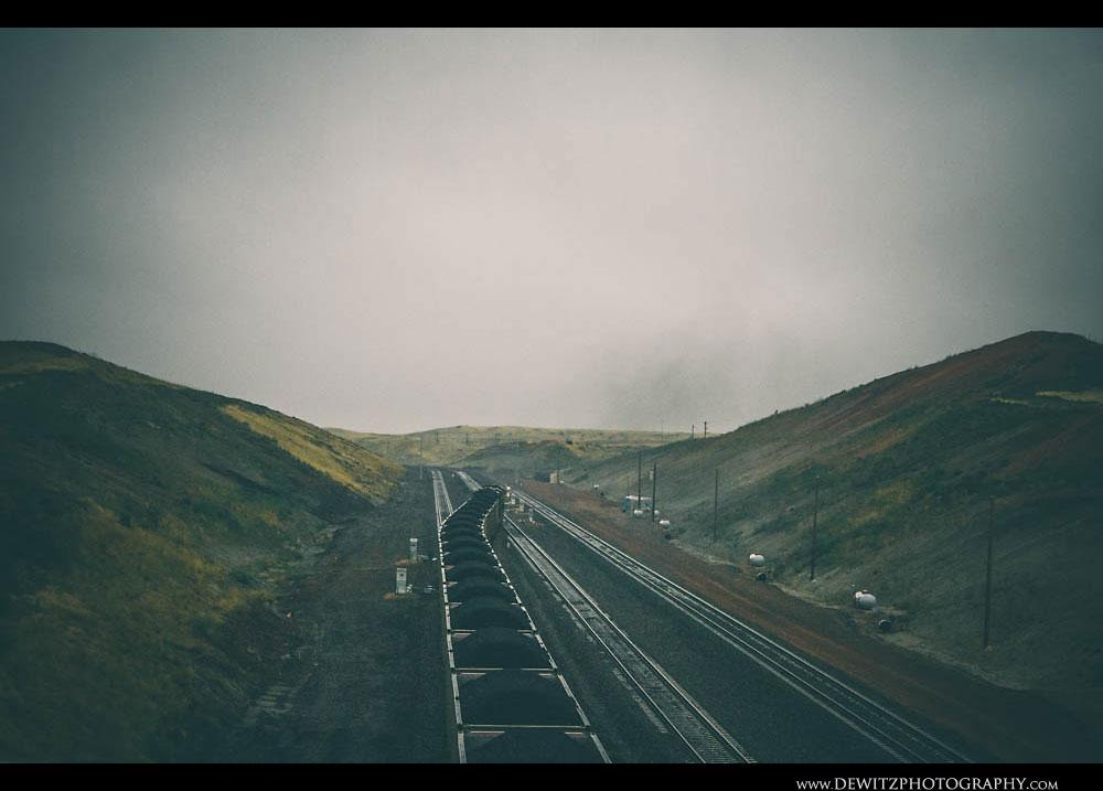 62Loaded Coal Train Grinds Up Wet Rails in the Rain