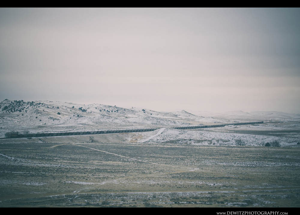 66Entire Coal Train in Snow Covered Wyoming Landscape