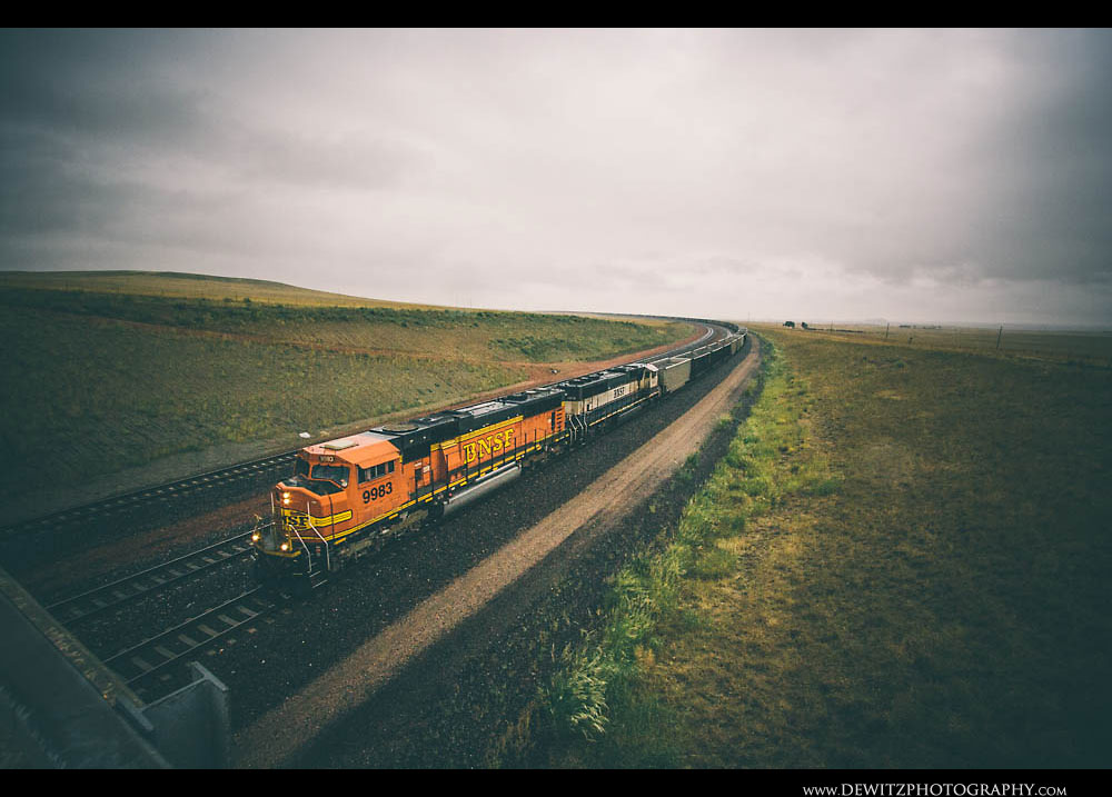 22BNSF Coal Train Rounds the Curve in the RAin