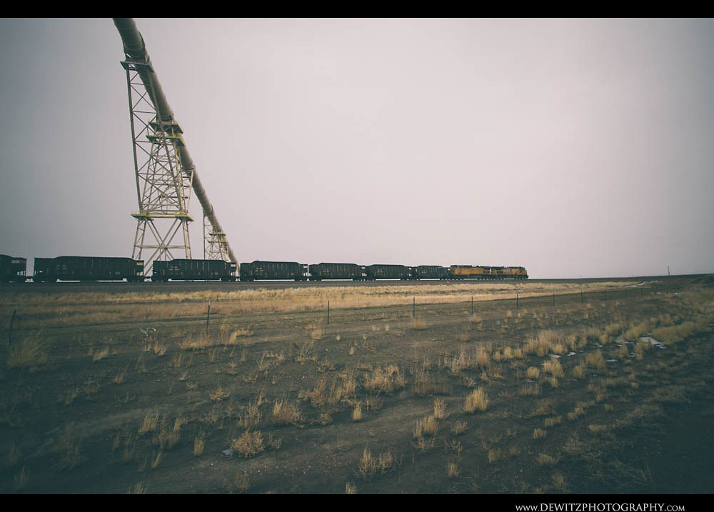 234Union Pacific Coal Train Rolls Under the Black Thunder West Conveyor
