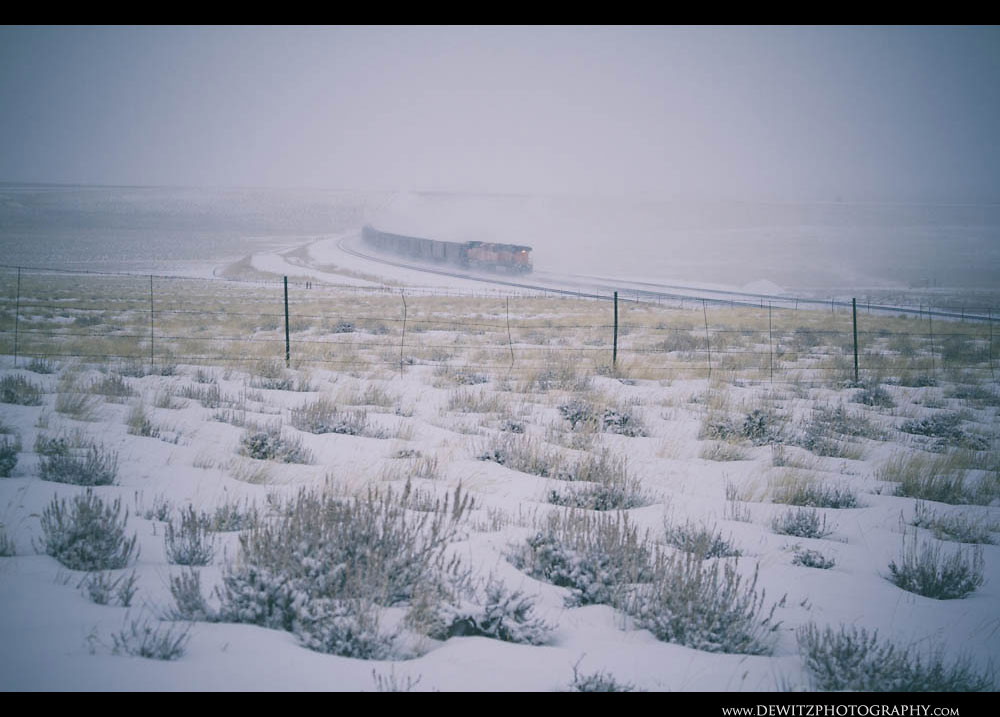 263BNSF Coal Train Kicks Up Snow as it Heads North Up the Orin Sub
