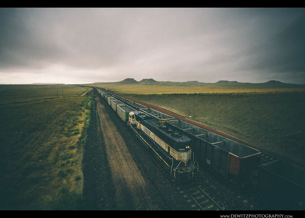 32BNSF Coal Trains Pass in the Rain