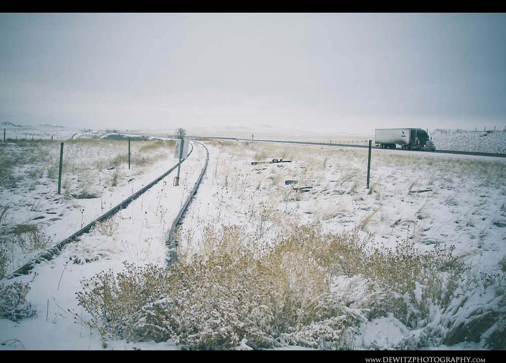 56Abandoned Railroad Tracks South of the Powder River Basin Along Highway with Semi