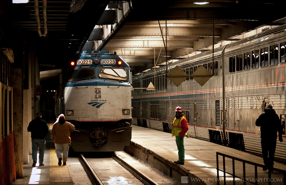 Amtrak 90225 sits under the city of Chicago waiting at Union Station.