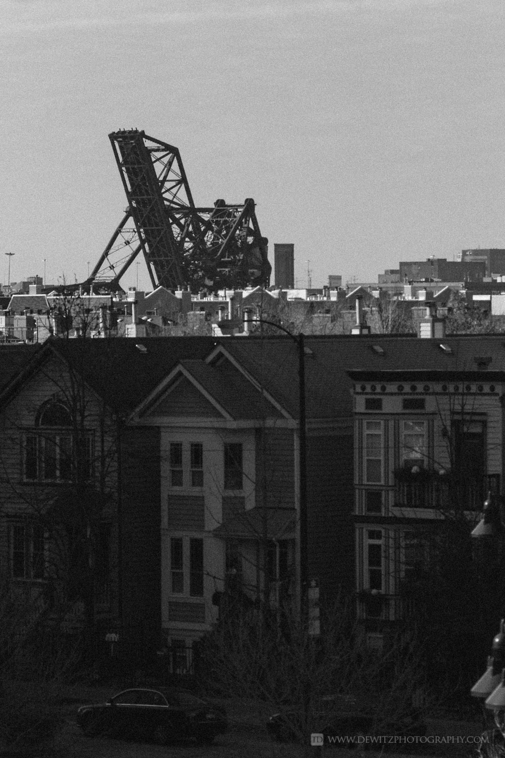 The Infrastructure that Feeds Chicago Union Station - Liftbridge Rises Above Chicago Townhouses