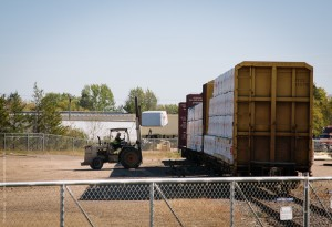 An Automated Building Components (ABC) employee unloads lumber off a bulkhead car that Wisconsin Northern delivered in Chetek, Wisconsin.