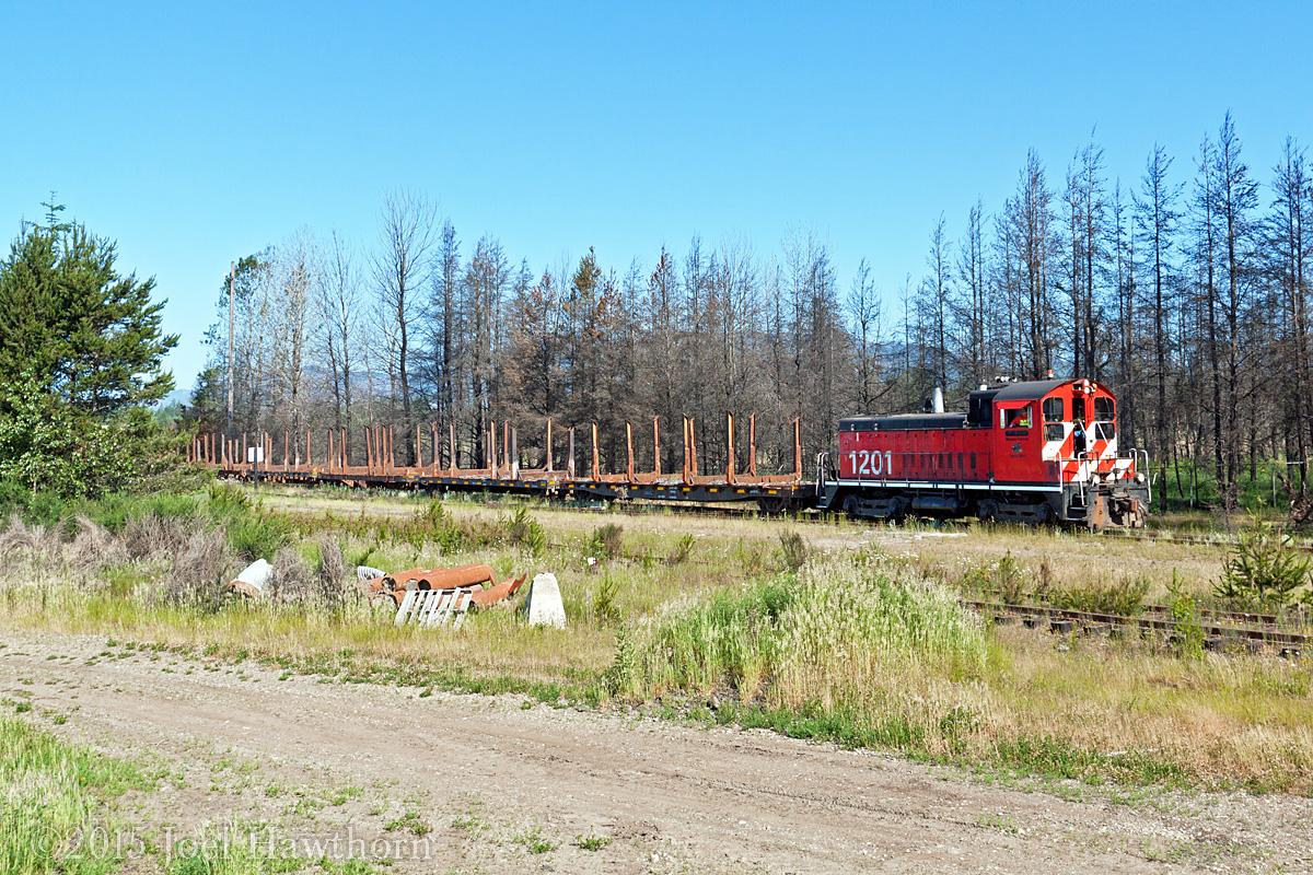 The last log train leaves Dayton Dry Sort yard.