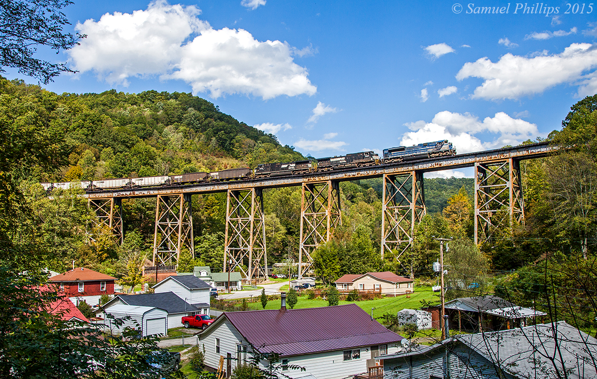 On a beautiful afternoon, train U86 grinds upgrade across the trestle at Covel led by EMDX SD70ACe demonstrator No. 2012 with a utility train in tow en-route to the Belews Creek Steam Staion near Winston-Salem, N.C. Most of the time, trains in this area will only run with NS power, but every now and then, something odd ball like this will pop up and surprise you.