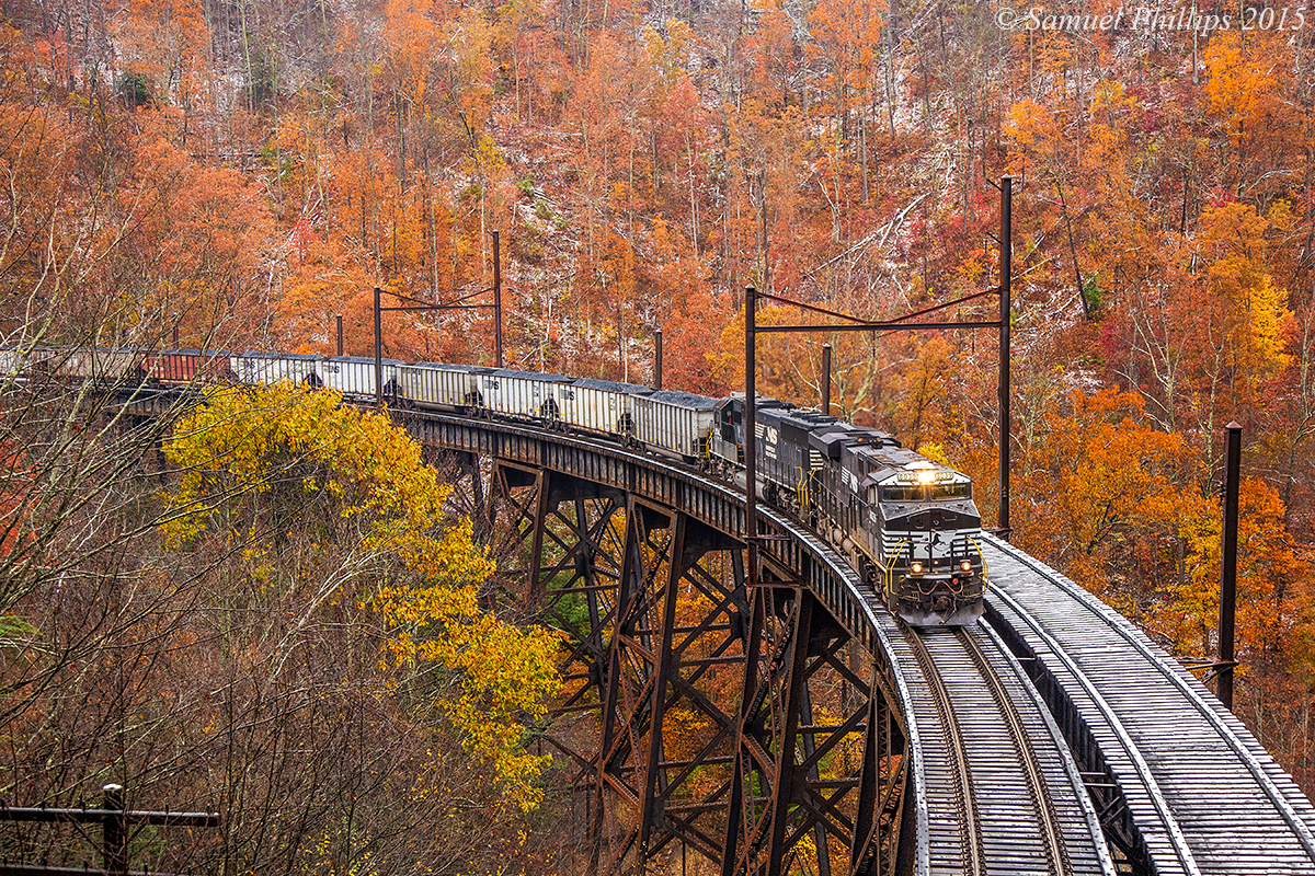 Stunning fall color and trace of snow off set this beautiful scene at Garwood, as train U87 grinds across the trestle with the first of two hill runs going to Clark's Gap. No. 8039 is leading the charge with one other locomotive in tow. The train is only around 60 loads, hence the 5 locomotive consist.