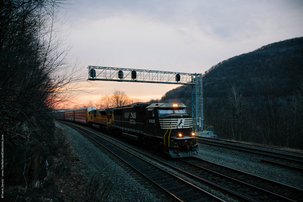 Norfolk Southern autorack train grinds around Horseshoe Curve on this beautiful late winter morning near Altoona, Pennsylvania.
